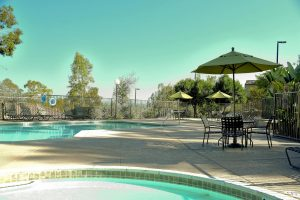 Pool, lounge areas, seating ares with outdoor umbrella
